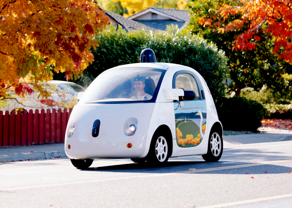 Google Driverless Concept Car on the street with passenge.